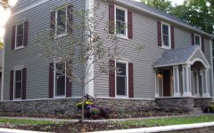 Gray Colonial Home With Dark Red Shutters