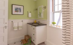 Green Cottage Bathroom With Black and White Tile Floor