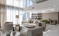 Luxury Apartment Living Room With High Ceiling and Metallic Accent
