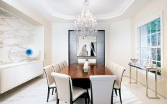 Minimalist White Art Deco Dining Room With Chandelier