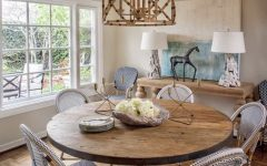 Natural Wood Table With White Wicker Chairs and Driftwood Lamps
