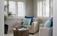Neutral Coastal Sitting Room With Blue Pillows