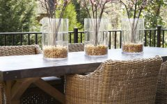 Pink Cherry Blossom Centerpieces and Wicker Armchairs Outdoor Dining