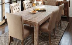 Rustic Dining Room With Wood Table and Elegant Chairs