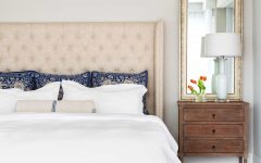 Traditional Bedroom With Upholstered Headboard and Antique Wood Nightstands