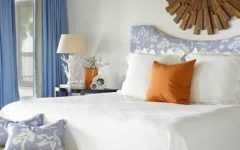 White Coastal Bedroom With Wooden Starburst Mirror