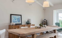 White Coastal Dining Room With Wood Table