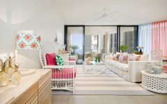 White Coastal Living Room With Hot Pink Cushions