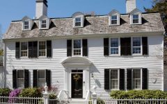 White Colonial Style Home With Clapboard Siding