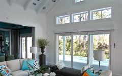 White Living Room With Soaring Ceilings and Coastal Decor