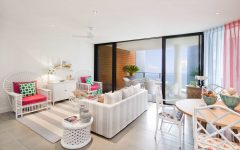 White and Pink Coastal Living Room With Black Framed Sliding Glass Doors