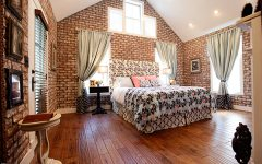 Best Classic Fabric Bedroom With Brick Wall and Wood Flooring