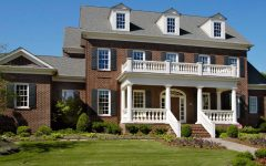 Brick House Architecture With White Pillars for Front Porch and Balcony
