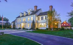 Classic Colonial Home With Gray Shingle Roof and Red Brick Chimneys
