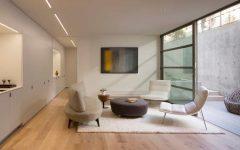 Minimalist Formal Living Room With Elegant Sofa and Light Hardwood Floors