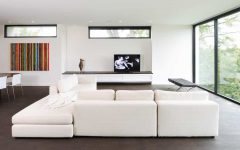 Modern Open Concept Living Room With White Walls and a Freestanding Tv