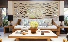 Plethora of Pillows and Cushion Top Wooden Sofa in Outdoor Living Space