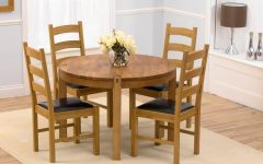 Round Oak Dining Tables and 4 Chairs